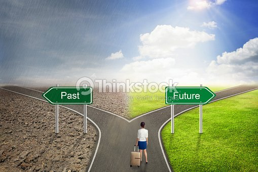 businessman concept past or future road to the correct way ストック