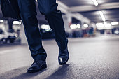 Businessman confidently walking at night