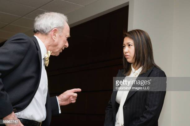 Businessman confronting employee