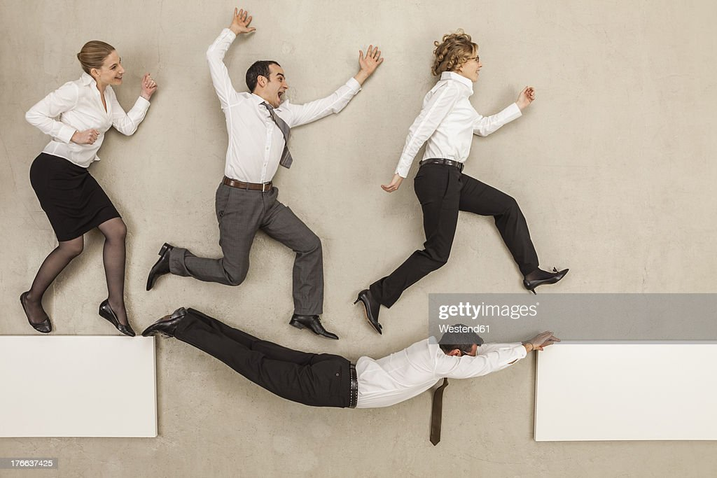 Businessman connecting gap of platform and business people crossing over it