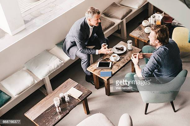 Businessman consulting customer in cafe