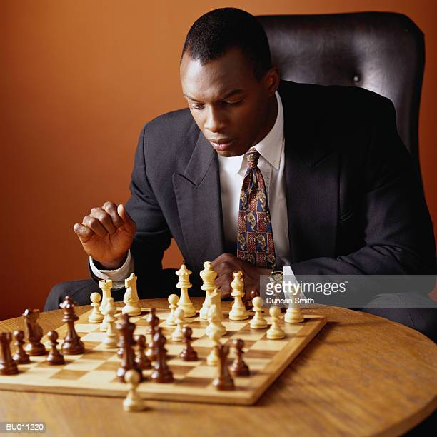 Businessman Contemplating a Chess Move