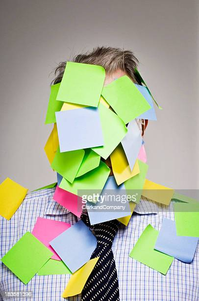 Businessman Covered In Multi-Colored Sticky Notes