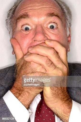 Businessman covering mouth : Stock Photo