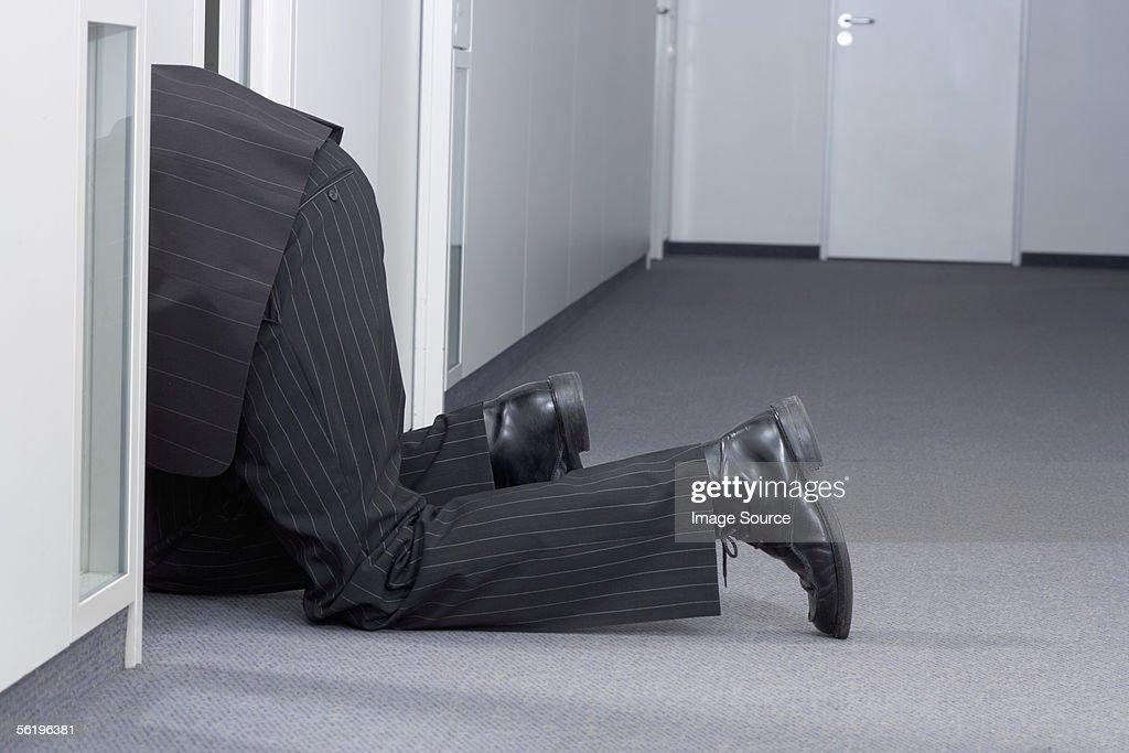 Businessman crawling on floor