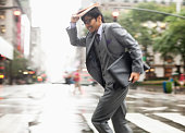 Businessman crossing city street