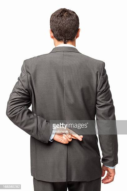 Businessman Crossing Fingers Behind His Back - Isolated