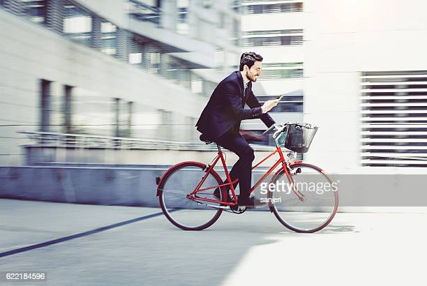 Businessman Cycling  and Using Phone