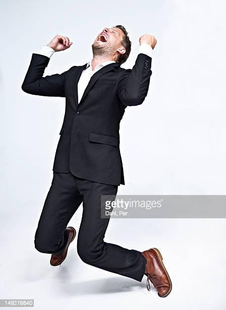 Businessman dancing and screaming
