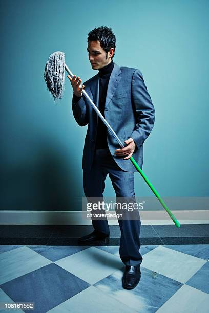 Businessman Dancing with a Mop