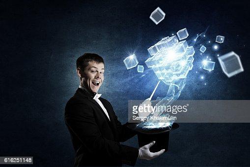 Businessman demonstrating magic . Mixed media : Foto de stock