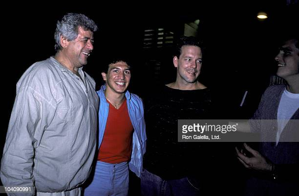 Businessman Dennis Stein athlete Ray Mancini and actors Mickey Rourke and Matt Dillon sighted on August 21 1985 at Elaine's Restaurant in New York...