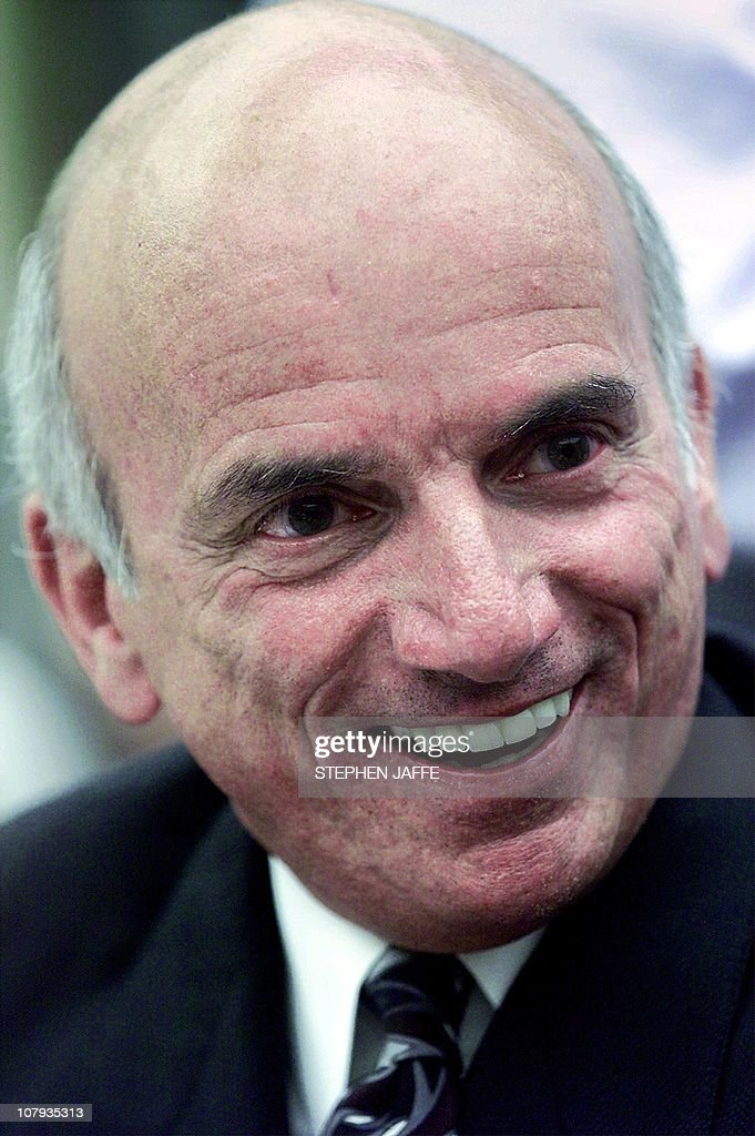 US businessman Dennis Tito laughs prior to testifying at the House Space and Aeronautics Subcommittee on Capitol Hill 26 June, 2001. The Subcommittee hearing was on space tourism and included astronaut Buzz Aldrin on the panel. Tito, the first space tourist, payed the Russians 20 Million USD to spend time in the International Space Station. AFP Photo Stephen JAFFE