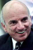 US businessman Dennis Tito laughs prior to testifying at the House Space and Aeronautics Subcommittee on Capitol Hill 26 June 2001 The Subcommittee...