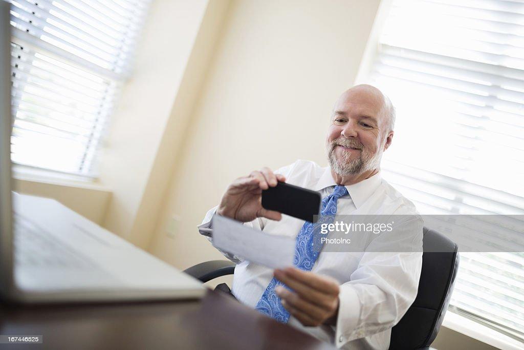 Businessman Depositing Check Through Smart Phone