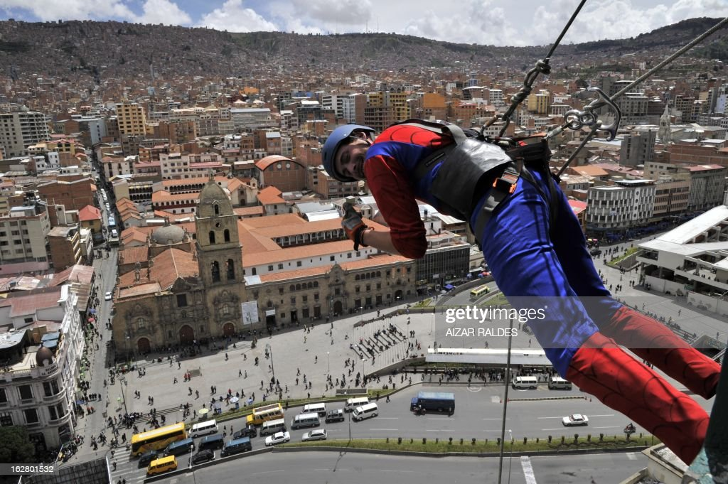 US businessman Derren Patterson, owner of the company 'Urban Rush', practices 'Rap-jumping' at a hotel in La Paz on February 27, 2013. Patterson went down some 50 meters from the 17th floor of a hotel to a terrace. 'Rap-jumping' is an extreme sport which name comes from the French word 'rapel' -descent of vertical surfaces with ropes and harnesses- and English word 'jumping'. AFP PHOTO/Aizar Raldes /