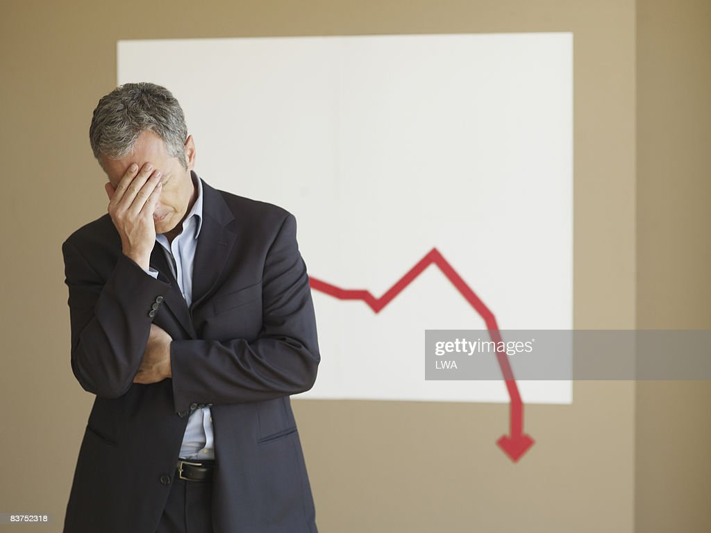 Businessman Disappointed With Projections : Stock Photo
