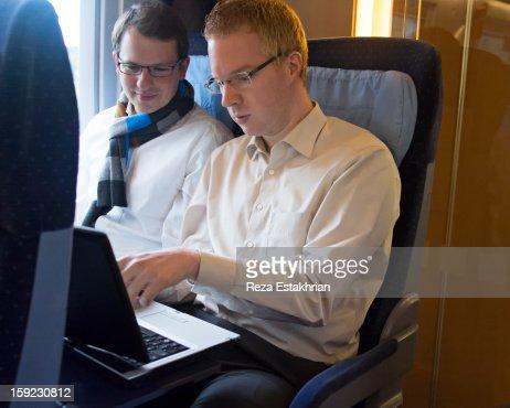 Businessman discuss work on laptop : Foto de stock