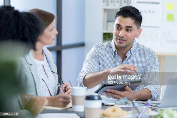 Businessman discusses current projects with colleagues