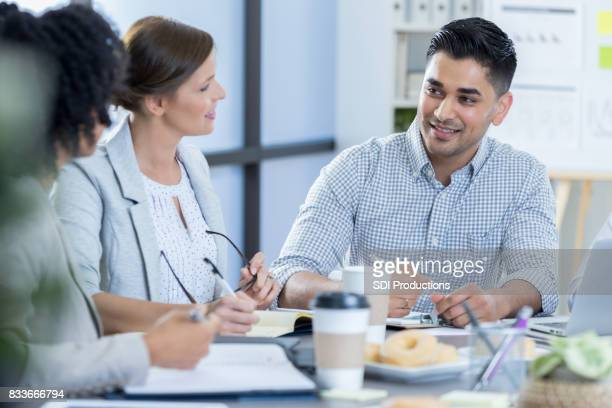 Businessman discusses something during meeting