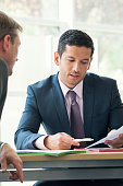 Businessman discussing contract with client