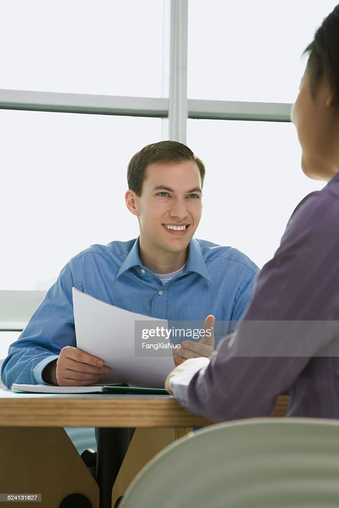 Businessman discussing with woman