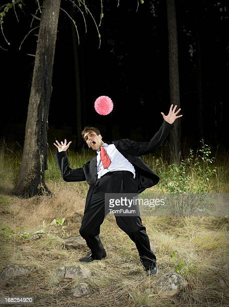 Businessman Dodging Ball