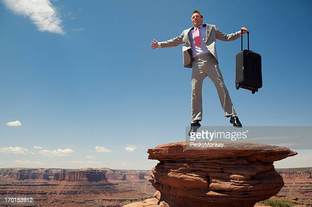 Businessman Does a High Flying Leap Above Grand Canyon