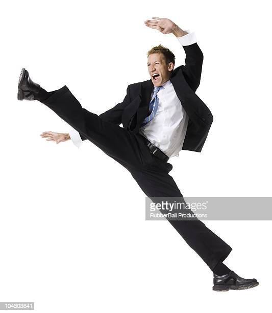 businessman doing a karate kick