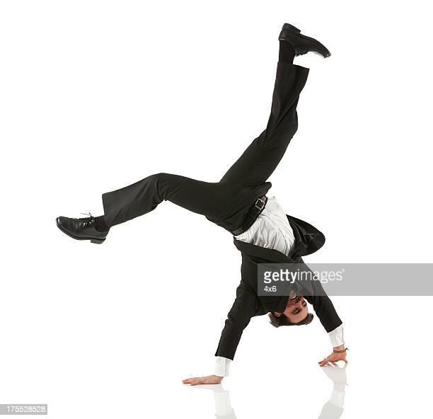 Businessman doing handstand