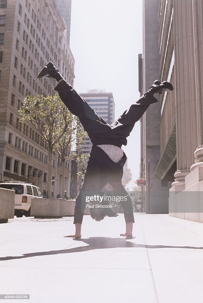 Businessman Doing Handstand : Stock Photo