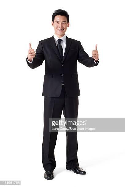 Businessman doing thumb-up