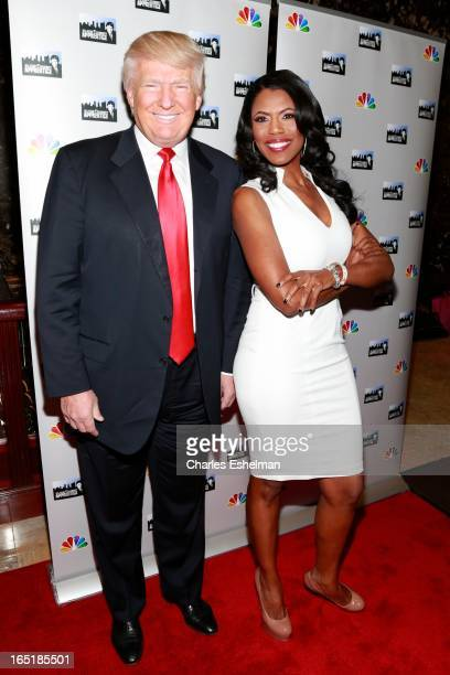 Businessman Donald Trump and actress Omarosa Manigault attend the 'AllStar Celebrity Apprentice' Red Carpet Event at Trump Tower on April 1 2013 in...