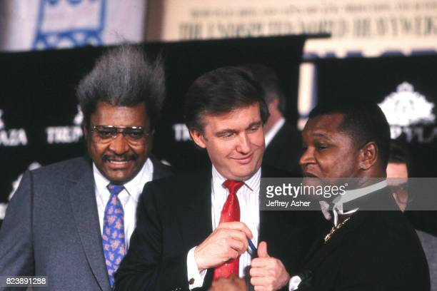 Businessman Donald Trump Boxing Promoter Don King and Promoter Butch Lewis at Tyson vs Holmes press conference at Trump Plaza Casino Hotel in...