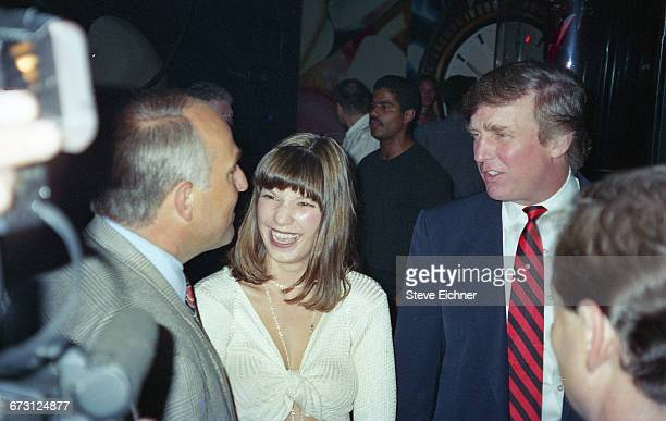 Businessman Donald Trump second from right at Club USA in New York New York September 28 1994 Other figures are unidentified