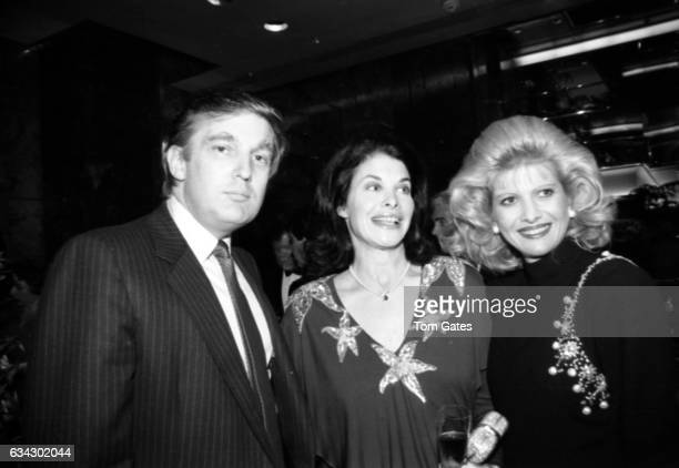 Businessman Donald Trump Sherry Lansing and his wife Ivana Trump at Trump Tower's Harry Winston Salon for the book 'Circle of Gold' which was written...