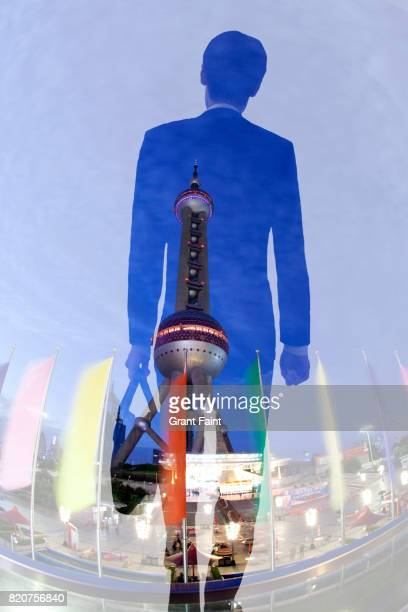 Businessman double exposure with tower.