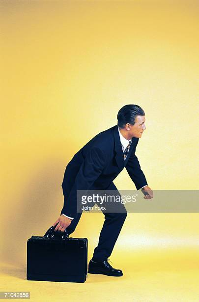 businessman dragging suitcase