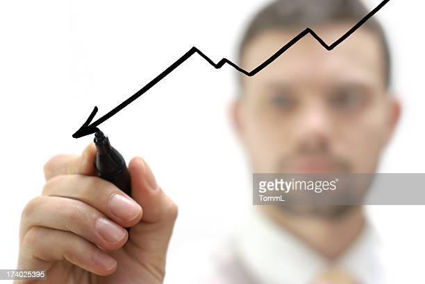 Empresario dibujo de una disminución gráfico/Gráfico