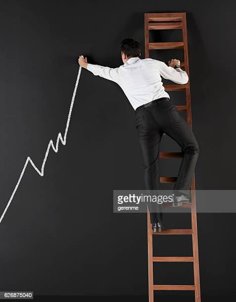 Businessman drawing an increasing graph