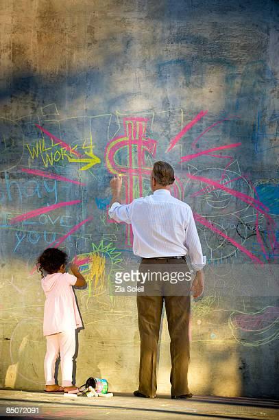 businessman drawing chalk graffiti
