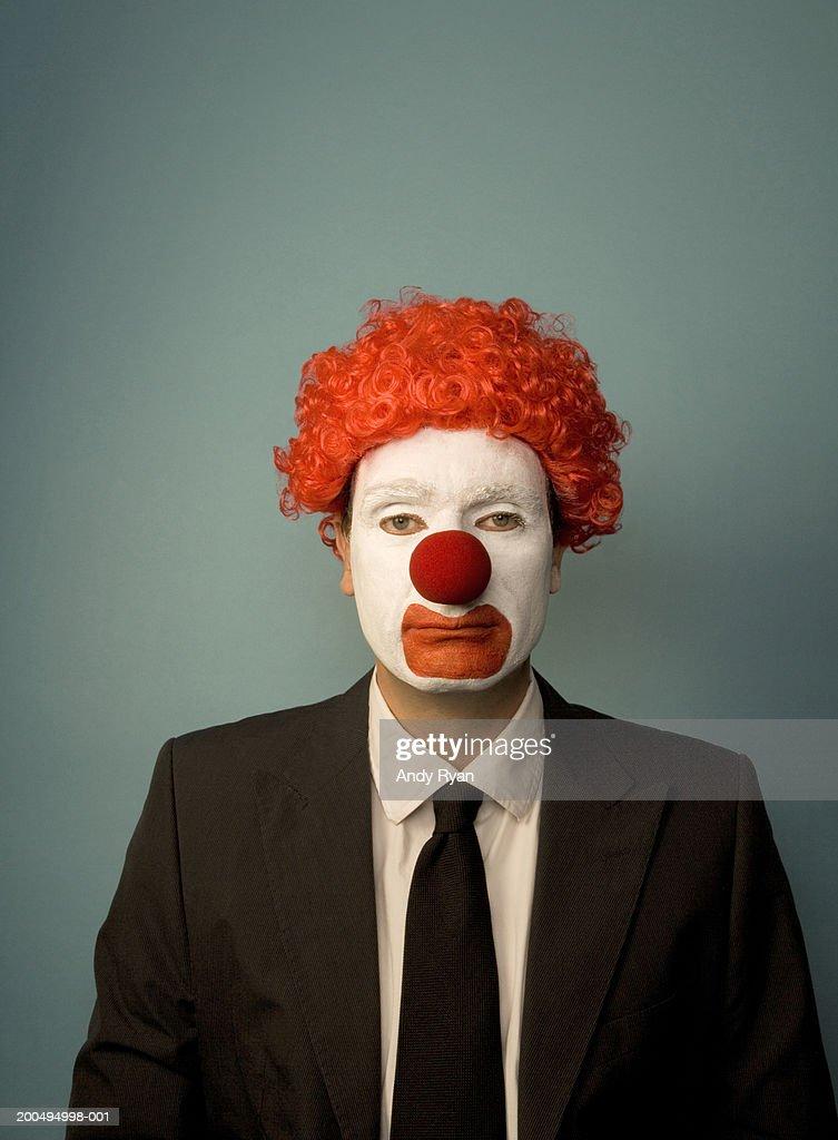 Businessman dressed as clown, front view, portrait