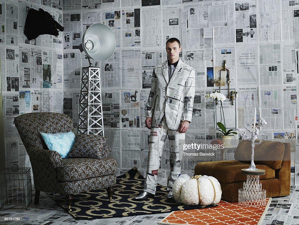 Businessman dressed in newspaper suit