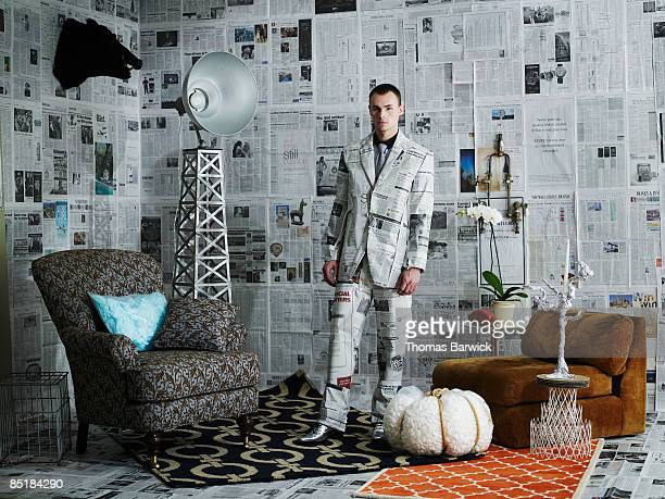 Businessman dressed in newspaper suit