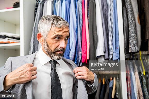 Businessman dressing at his walk-in closet
