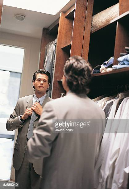 Businessman Dressing in Front of Mirror