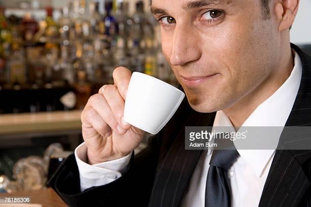 A businessman drinking an espresso