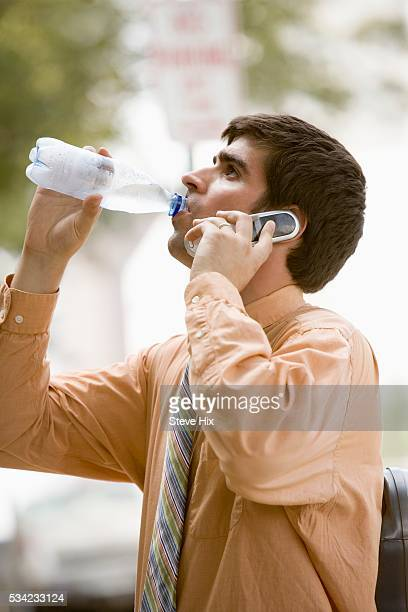 Businessman Drinking Bottled Water