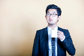 businessman drinking cup of coffee