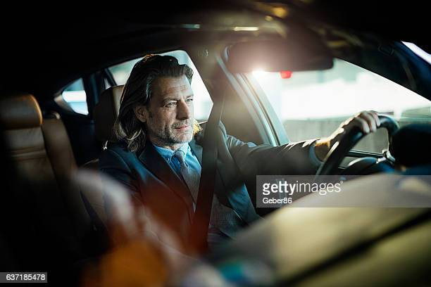 Businessman driving a car
